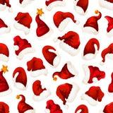 圣诞老人红色帽子圣诞节无缝的样式 库存照片