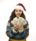 圣诞老人红色帽子的逗人喜爱的年轻真正的非洲行家女孩在白色背景等待的冬天Christmass 库存图片