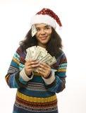 圣诞老人红色帽子的逗人喜爱的年轻非洲女孩与 库存图片