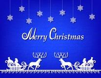 圣诞老人纸剪影蓝色背景 库存照片