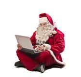 圣诞老人膝上型计算机 免版税库存照片