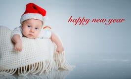 圣诞老人衣服的婴孩。 图库摄影