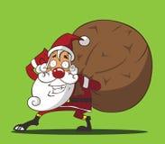 圣诞老人袋子礼物 免版税库存图片