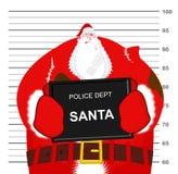 圣诞老人被打在警察局 圣诞节战斗 坏Sa 免版税库存照片
