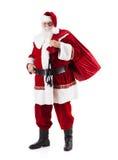 圣诞老人运载的大袋圣诞节礼物 免版税库存图片