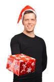圣诞老人递一件礼物 免版税库存图片