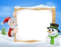圣诞老人雪人动画片标志 库存照片