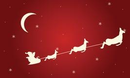 圣诞老人雪橇和鹿剪影  库存照片