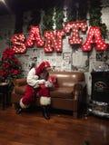 圣诞老人项目是comin ta镇 库存照片