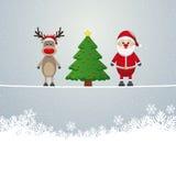 圣诞老人驯鹿结构树麻线多雪的背景 库存图片