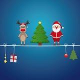圣诞老人驯鹿结构树麻线蓝色背景 库存照片