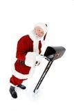 圣诞老人:圣诞老人从邮箱得到邮件 图库摄影