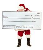圣诞老人:拿着过大的检查的圣诞老人 免版税库存照片