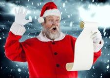 圣诞老人读取愿望 图库摄影