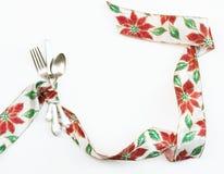 圣诞节一品红丝带餐位餐具 图库摄影