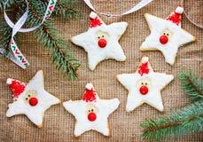圣诞节与冰形状的圣诞老人的姜饼曲奇饼为 库存图片