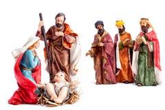 圣诞节与圣洁家庭和三个圣人的诞生场面,隔绝在白色背景 免版税库存照片