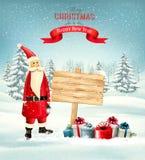 圣诞节与圣诞老人和木标志的假日背景 图库摄影