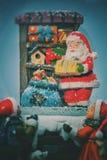 圣诞节与圣诞老人的雪球和礼物里面在白色背景 免版税图库摄影