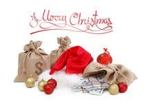 圣诞节与在白色隔绝的金钱的礼物概念 免版税库存照片