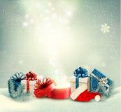 圣诞节与礼物和不可思议的箱子的假日背景 库存图片
