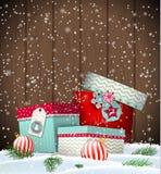 圣诞节与礼物盒的贺卡在随风飘飞的雪 库存照片