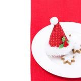圣诞节与红色盖帽和曲奇饼的桌设置,被隔绝 免版税图库摄影