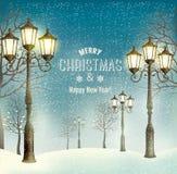 圣诞节与葡萄酒路灯柱的晚上风景 免版税库存图片