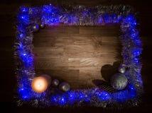 圣诞节与蜡烛光的装饰框架 免版税库存图片