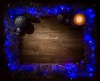 圣诞节与蜡烛光的装饰框架 免版税库存照片