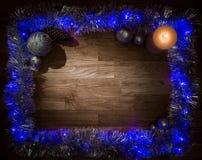 圣诞节与蜡烛光的装饰框架 库存照片