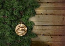 圣诞节与装饰的杉树在一个木板 图库摄影