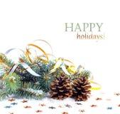 圣诞节与金飘带和星的冷杉分支 免版税库存图片
