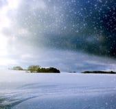 圣诞节与降雪的冬天背景 库存图片