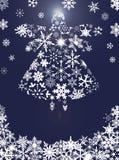 圣诞节与雪花的天使飞行 免版税库存照片