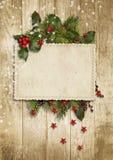 圣诞节与霍莉,冷杉木的葡萄酒卡片 免版税库存照片
