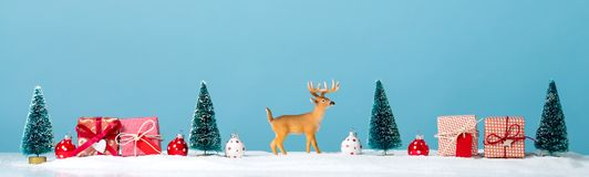 圣诞节与驯鹿的假日题材 免版税图库摄影