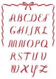 圣诞节丝带字母表 免版税库存照片