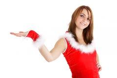 圣诞节介绍妇女 库存图片