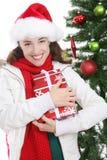 圣诞节俏丽的妇女 免版税图库摄影
