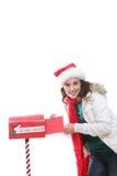 圣诞节信函邮寄的妇女 免版税库存照片