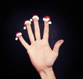 圣诞节假日概念 在圣诞老人帽子的愉快和不快乐的面孔 库存照片