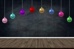 圣诞节假日球装饰垂悬在学校类黑板背景的 图片书刊上的图片设计的拷贝空间 免版税库存照片