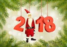 圣诞节假日背景与2018年和圣诞老人 库存照片