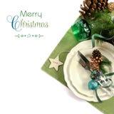 圣诞节假日绿色题材桌餐位餐具 库存图片