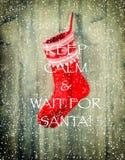 圣诞节储存 与垂悬红色袜子的被弄脏的背景 免版税库存照片
