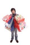 圣诞节充分的礼品供以人员年轻人 免版税库存图片