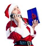 圣诞节克劳斯・圣诞老人电话妇女 免版税库存图片