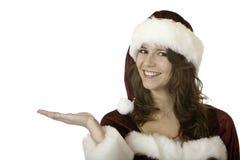 圣诞节克劳斯现有量拿着当前圣诞老&# 免版税图库摄影