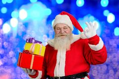 圣诞节克劳斯礼品圣诞老人 免版税库存照片